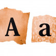 Header and capital letter A on the old paper — Stock Photo