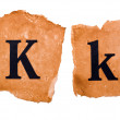 Header and capital letter K on the old paper — Stock Photo