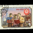 USSR - CIRCA 1959: A stamp printed in the USSR shows Friendship Soviet and the Chinese students, circa 1959 — Lizenzfreies Foto