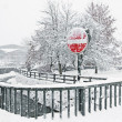 Stock Photo: A stop sign in Kirhberg, Austria, Tirol, snowfall