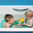 One-year-old twins play a bathroom — Stock Photo