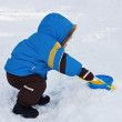 One-year-old boy play in snow — Stock Photo