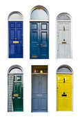 Set of typical English doors on the white — Stock Photo