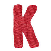 Letter K alphabet, knitted spokes structure — Stock Photo