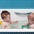Two-year-old twins play a bathroom — Stock Photo