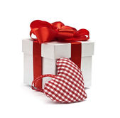Red gift and textile checkered heart — Stock Photo