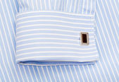 Striped blue shirt and sleeve with a cuff link — Stock Photo