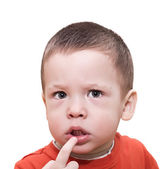 The two-year-old child reflected a finger in a mouth — Stock Photo
