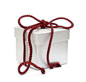 Box tied by a red cord — Stock Photo