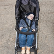 Kid sleeps in stroller — Stock Photo #28870363