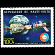 Stock Photo: Stamp printed in REPUBLIQUE DE HAUTE VOLTshows cooperation spatiale USA-URSS Apollo - SOUZ