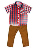 Red plaid shirt with a short sleeve and mustard jeans — Stock Photo