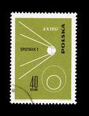 En stämpel som tryckt i polen visar sputnik 1 desselberger — Stockfoto