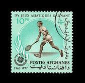 Un sello impreso en afganistán muestra iv jeux asiatiques gagnant — Foto de Stock