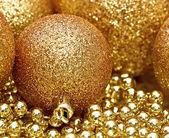 Golden Christmas spheres — Stock Photo