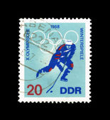 A stamp shows winterspiele X.olympische — Stock Photo