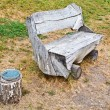 Rough wooden bench and garbage can — Stock Photo