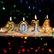 Stock Photo: New year 2014 - candles with snow