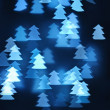 Blue christmas background form of a New Year's fir-tree — Stock Photo
