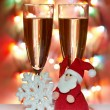 Christmas toys, wine glasses and santa cap  — Stock Photo