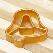Gold form for cookies a bell — Stock Photo