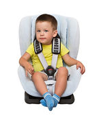 Boy sits in an automobile children's chair — Stock Photo