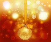 Golden Christmas sphere with ribbon — Stock Photo