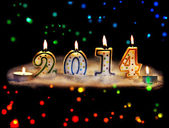 New year 2014 - candles with snow — Stock Photo