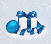 Gift and Christmas sphere — Stock Photo
