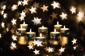 Stars and candles — Stock Photo