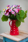 Bouquet of flowers in a jug. — Stock Photo