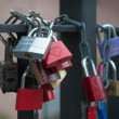 Padlocks chain fastened to the bridge. - Stock Photo