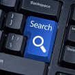 Search button computer keyboard with magnifying glass. — Stock Photo