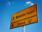 Mobile apps road sign with cart and smartphone. — Stock Photo