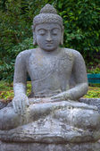 Stone Buddha in the lotus position. — Stock Photo