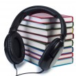 Headphones and a stack of books. - Stock Photo