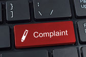 Complaint button keyboard with pen icon. — Stock Photo