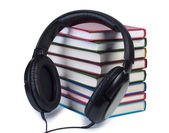 Headphones and a stack of books. — Stock Photo