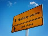 Holiday season road sign background sky. — Stock Photo
