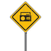 Old shabby yellow sign with an old-fashioned cassette recorder. — Stock Vector