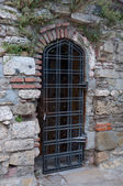 Door grille in an old brick wall. — Stock Photo