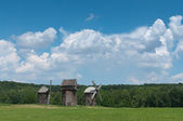 Three old wooden windmills. — Stock Photo