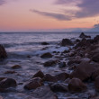 Rocky shore during a beautiful sunset over the sea. — Stock Photo