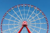 Ferris wheel on blue sky background. — Stock Photo