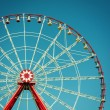 Ferris wheel attraction on blue sky background. — Stock Photo