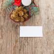 Christmas composition on wood with empty white card — Stock Photo