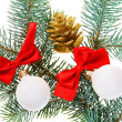 Christmas balls, red bows and cone on fir branch, isolated on wh — Stock Photo #12864104