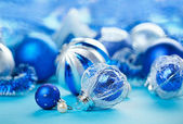 Christmas decoration balls on blue background, closeup — Stock Photo
