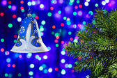 New Year decorations bell on multicolor circles bokeh background — Stock Photo