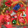Many different Christmas decorations on red background — Stock Photo #12871177